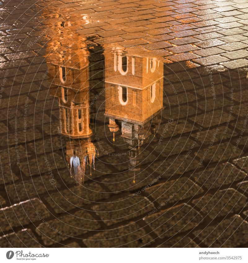 The reflection of the St. Mary's Basilica in Krakow architecture basilica building cathedral catholic church city cityscape cobblestone Cracow culture europe