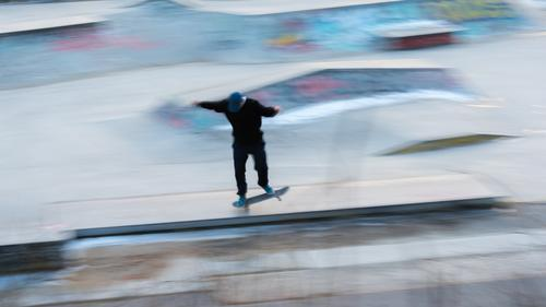 A skater in motion at a stunt action active activity Art awesome balance Berlin blur effect blurry board city citylife cityscape cool culture equipment extreme