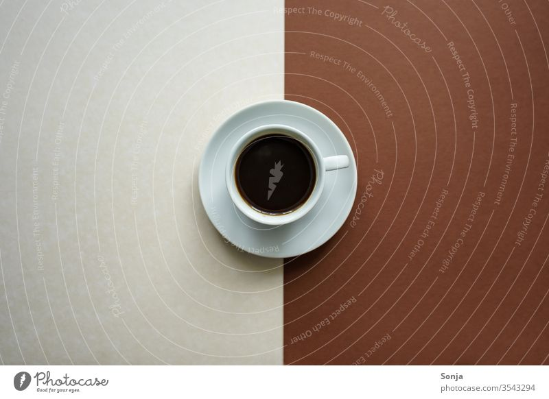A white cup of coffee and a saucer on a white and brown background, contrasts Coffee Beverage Espresso Black Strong Aromatic Hot Cup Saucer Brown White