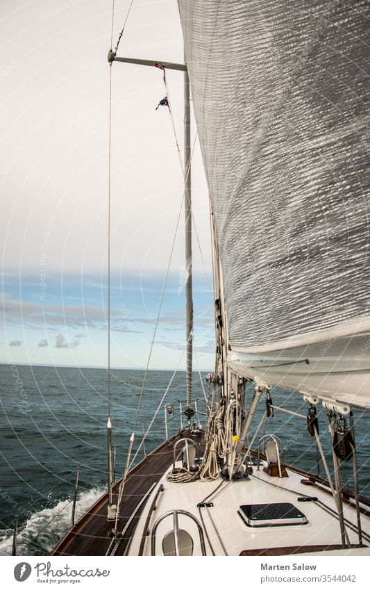 life is better with sails up sky blue white boat ocean sailing sea wind yachting travel water sport sailboat mast genoa sunny adventure deck luxury wave