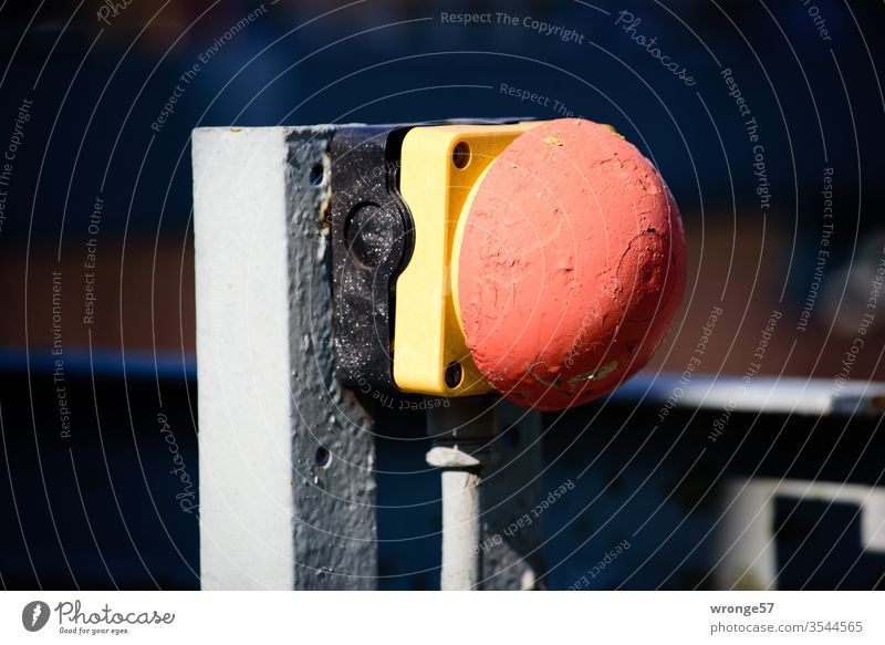 Emergency stop button on a steel construction emergency stop Safety switch Safety button Angle iron Industry Colour photo variegated Red Yellow Multicoloured