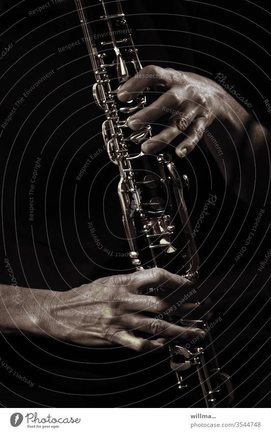 Solo on the clarinet Clarinet hands Music Musical instrument Woodwind instrument Musician Make music Sound