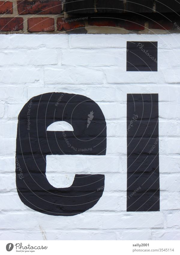 a... Egg Letters (alphabet) writing Inscription Wall (building) Facade black-white black on white Brick wall great lowercase pamphlet Wall (barrier) Characters
