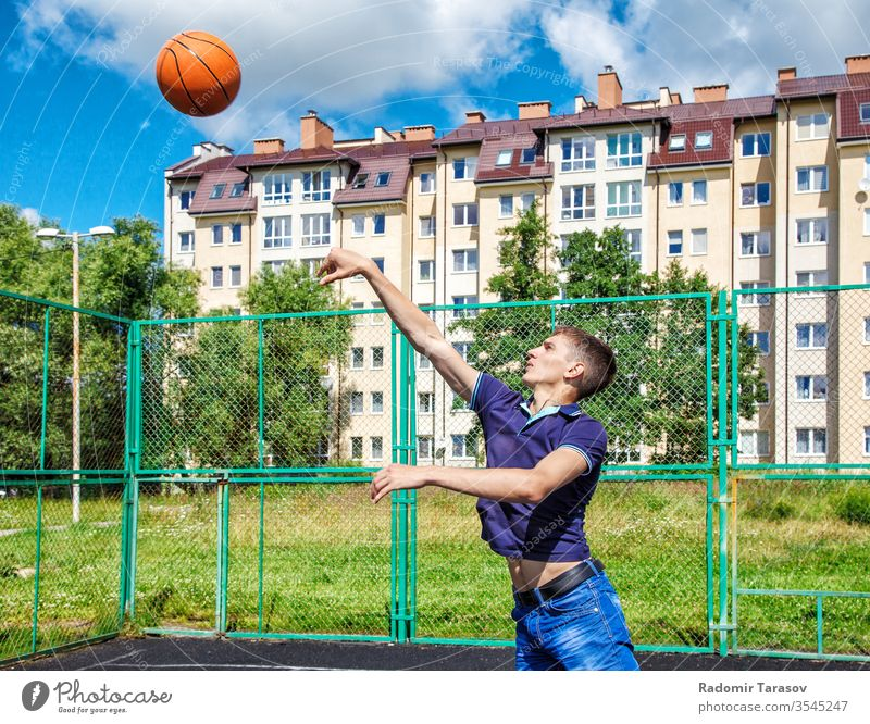 young man is training in a basketball game on the playground on a sunny summer day sport active athlete player fit court lifestyle healthy action athletic