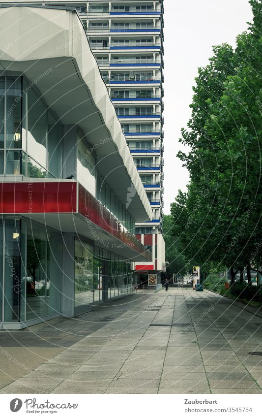 Sidewalk, facade and high-rise with perspective view in Berlin-Mitte Facade High-rise off Perspective Central perspective GDR socialist Modern slabs Street Red