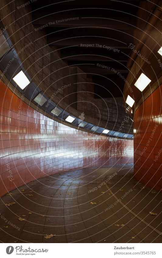 Tunnel with orange tiles in right-hand bend with light reflections Orange Light Reflex lamps Curve End Downward mirror Concern Fear Fear of the future Berlin