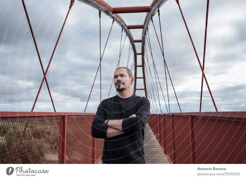 Bald cool man in pedestrian bridge portrait bald casual clothing day daytime ethnicity fashion fashionable handsome happy spain leisure activity lifestyle