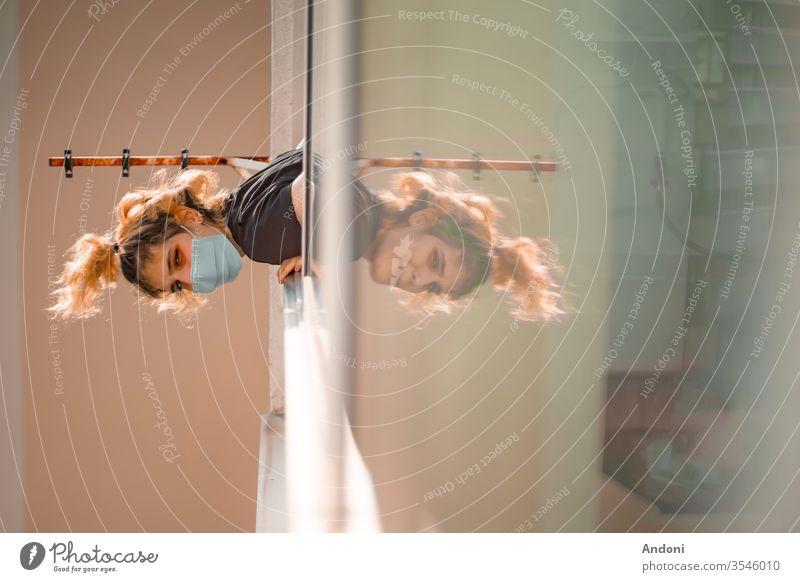 Girl in the window with medical mask during the covid quarantine Influenza pneumonia Contagious sars Bacterium Illness Corona virus corona Mask infectious Virus