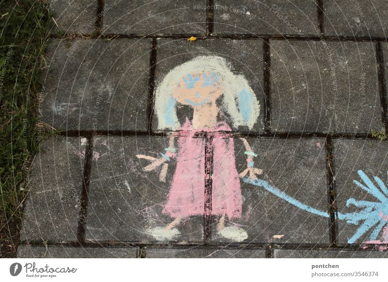 Children's drawing, children's art from street chalk. A painted girl holding something in her hand. Child's play Children's game Drawing
