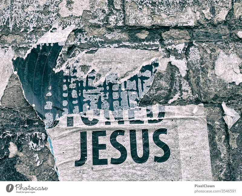 Graffiti on the wall with the theme Jesus Belief Religion and faith Exterior shot Jesus Christ Christianity Symbols and metaphors Catholicism