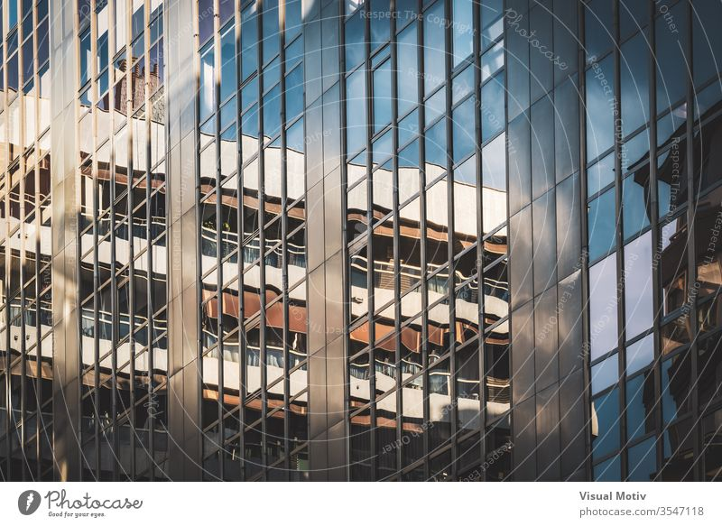 Glass windows of an office building facade architecture architectural architectonic urban metropolitan constructed edifice structure geometric geometrical
