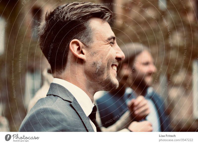 man - happy - laugh - enjoy Man 18 - 30 years brunette Suit suit-wearer Facial hair Laugh lines pretty To enjoy Joy Guest Wedding muck about in common Gray