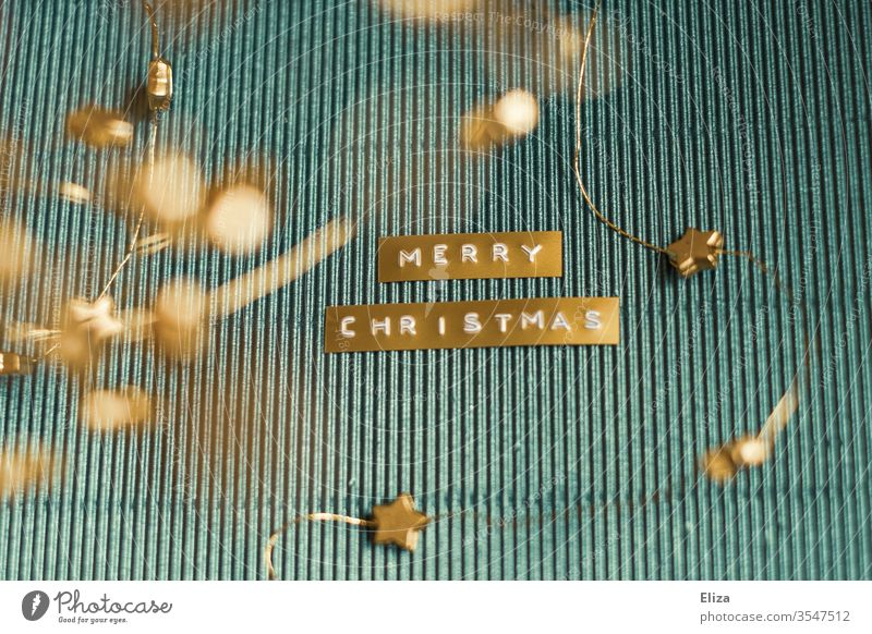 Merry Christmas. Christmas in gold and blue. English merry christmas Decoration Blue golden Card Adorned Corrugated board Design Text authored