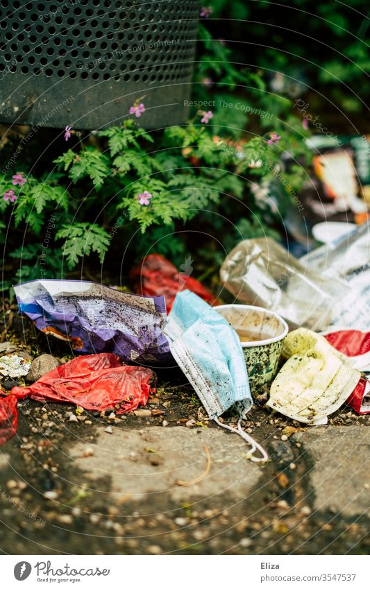 Medical mouthguard that lies on the floor among other garbage Mask Trash med mns filth jettisoned Dirty disgusting Defective dustbin used environmental problem