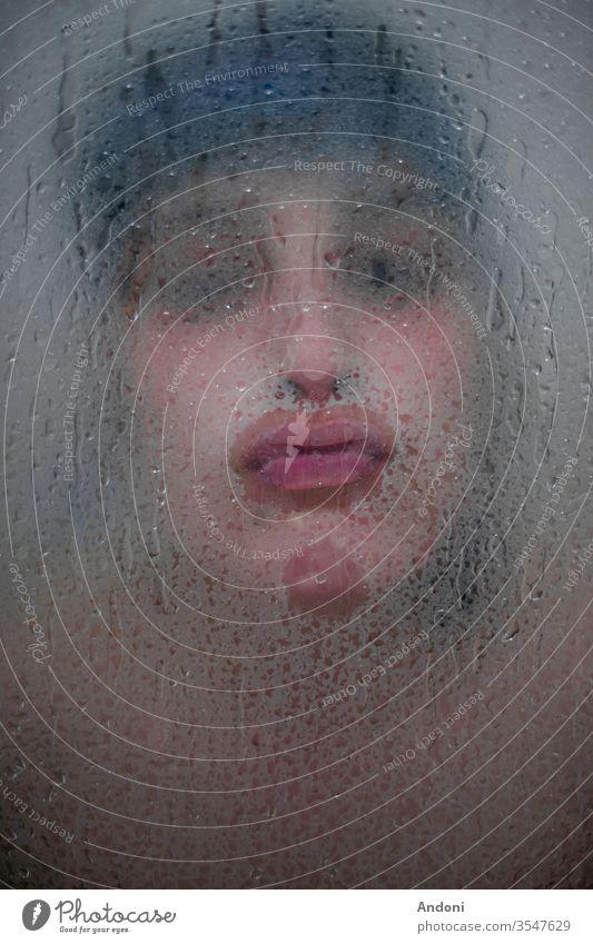 Girl kissing throught bath glass Portrait photograph Shallow depth of field Colour photo Interior shot Copy Space bottom Foam bath Bathtub Personal hygiene