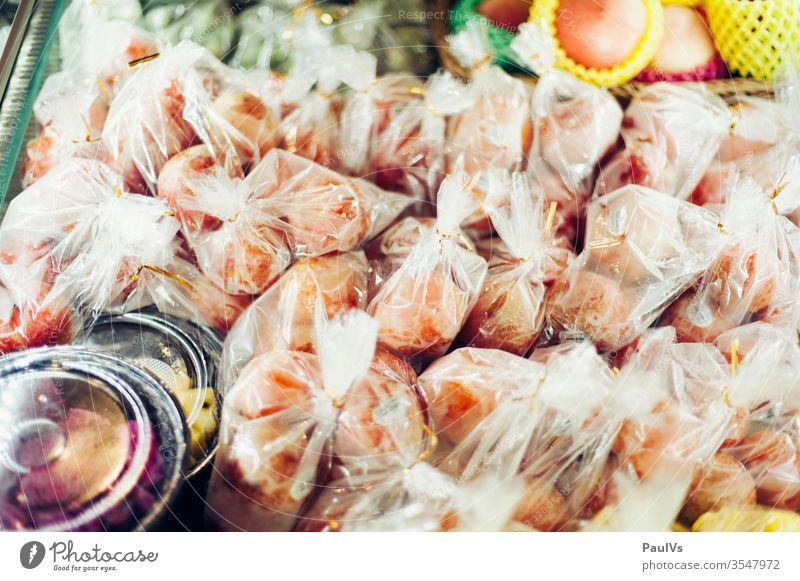 Plastic packed fruit Fruit in Asia fruits Markets Showcase plastic Fresh vitamins Mango Eating Food Nutrition Healthy Mature Delicious Healthy Eating Diet