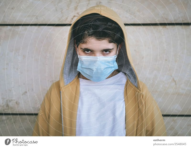 Coronavirus,angry boy with medical mask coronavirus Child Virus Epidemic pandemic Meditative Boy (child) Quarantine covid-19 Symptom medicine Healthy Death