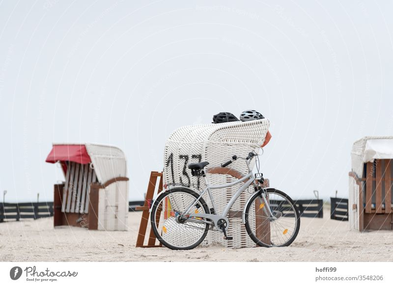 wicker beach chair, two helmets a bicycle by the sea Bicycle Helmet Ocean Beach Coast North Sea Baltic Sea Sand Sun Tourism Relaxation Island Sky