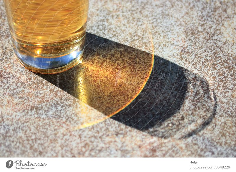 Soft drink in the sunshine with shadow and reflection Beverage Glass Apple spritzer Cold drink Table Light Shadow Sunlight Illuminate Exceptional Detail Yellow