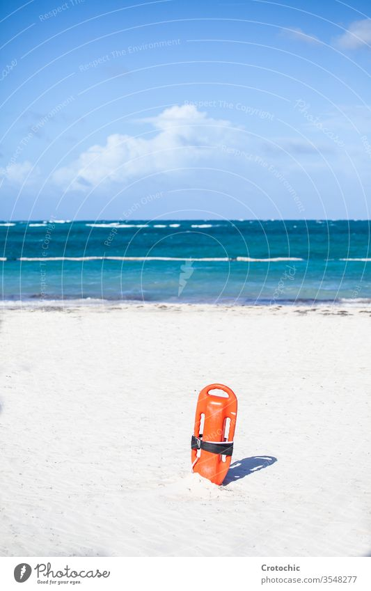 Floater of a lifeguard diving into the sand vertical floater horizon lines waves windy sea ocean danger sandy sun sunbath shadow sky alone front stuck shore
