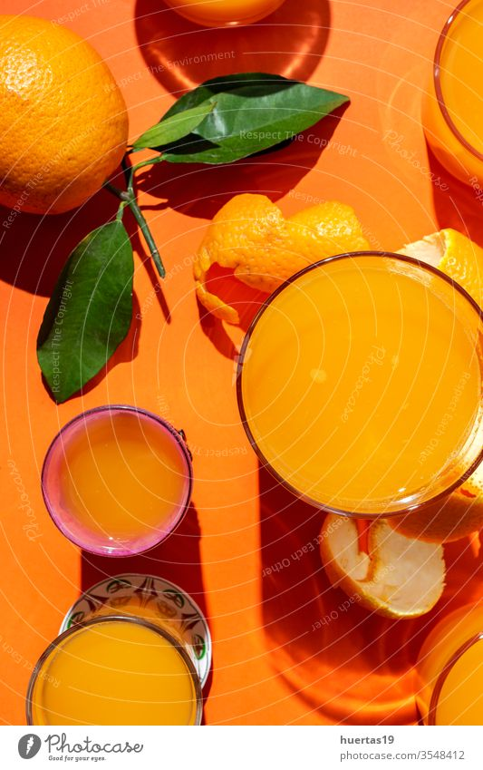 Orange juice from above on coloured backgrounds. oranges Fresh fruit Healthy Food Citrus fruits Juice Mature Drinking natural Slice sunligth Juicy Beverage