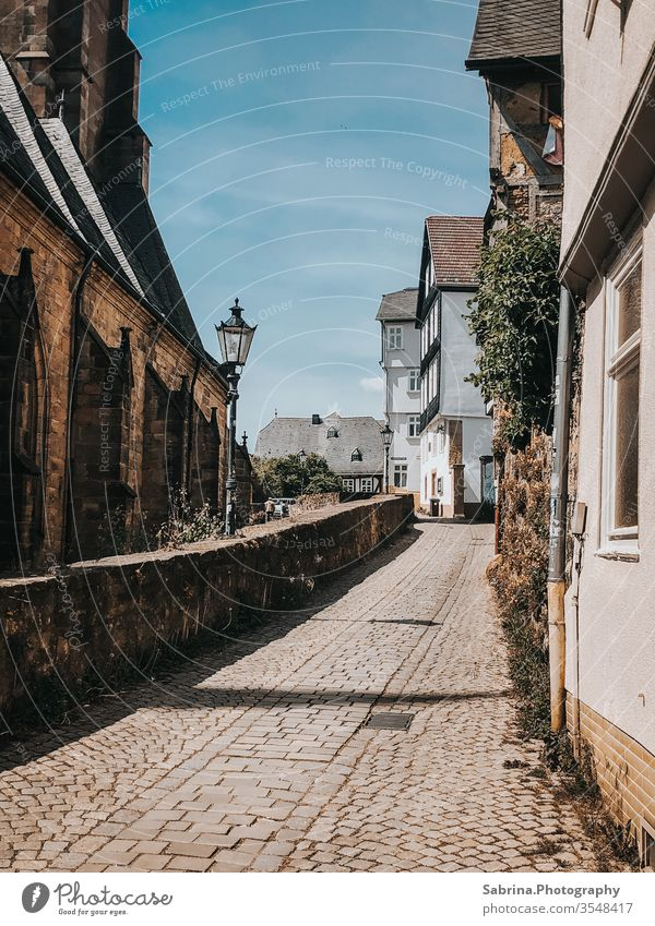 Small street in the upper town of Marburg, Hesse, Germany Europe Deserted Old town Half-timbered facade Half-timbered house Street Street lighting Road traffic