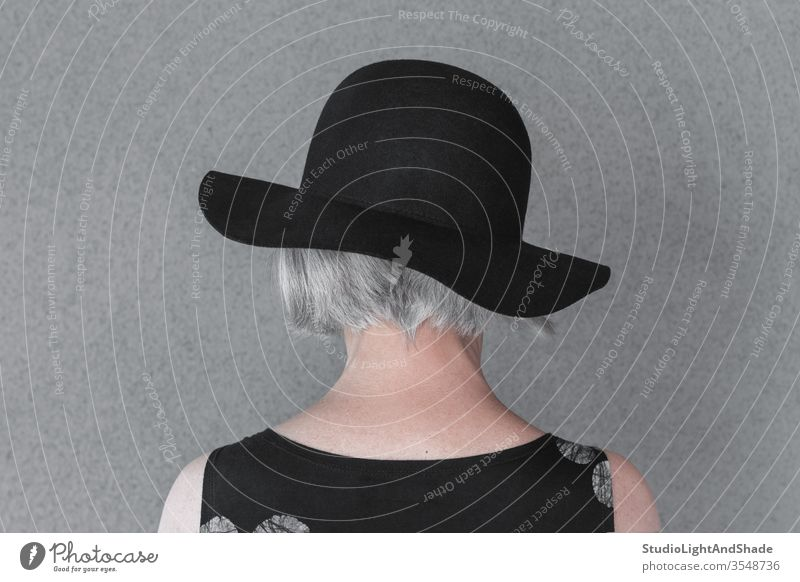 Gray-haired lady wearing black hat head neck gray grey gray-haired person woman female 50s 60s back fashion fashionable dress elegant style stylish senior age