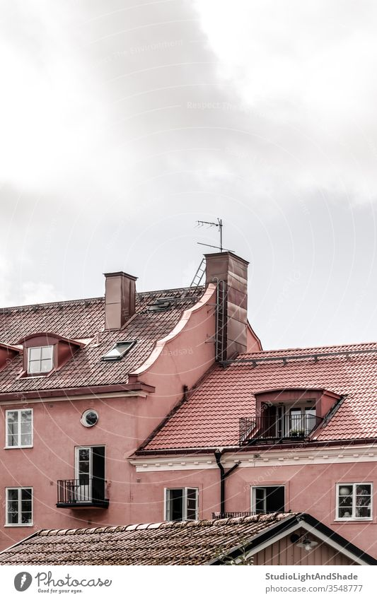 Tiled rooftops of pink European buildings roofs tile tiled house houses home homes windows outdoor exterior chimney wall Stockholm Sweden Swedish Scandinavia