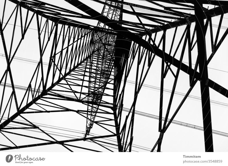 Stand under the power pole and look up Electricity pylon Pole Metal Construction Sky Energy industry Technology High voltage power line electricity