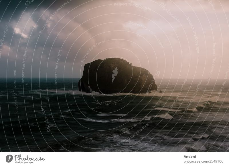 Rock island in brave sea Central perspective Copy Space bottom Copy Space left Experiencing nature Force of nature Determination Passion White crest Portugal