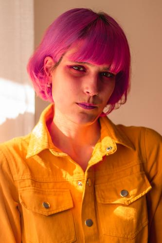 Woman withe pink hair Black Cigarette Smoke Laughter Face Skin Pink Portrait photograph Moody Blaze Smoking Eyebrow Grinning serious yellow