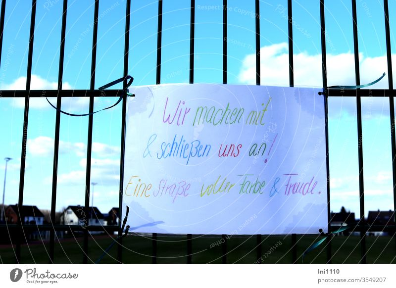 handwritten poster with colorful writing as a sign of solidarity during Corona corona virus Solidarity Compassion Loneliness Attachment stick together