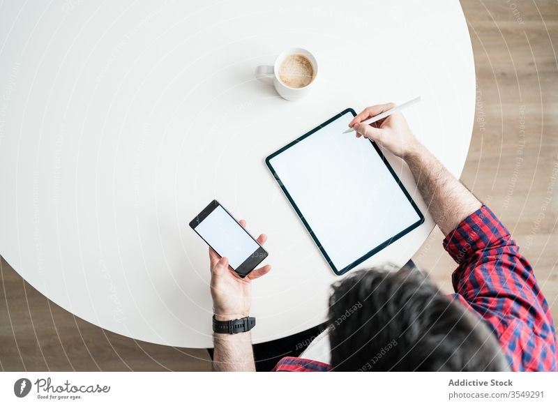 Young man working from home graphic business technology modern young interior internet job workplace table freelance male house room icon workspace hipster