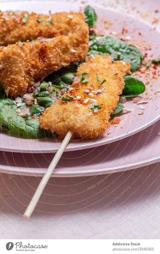 Battered chicken skewers in fried panko on restaurant table breaded food crispy snack meal golden appetizer dinner crunchy gourmet coated delicious cooked hot
