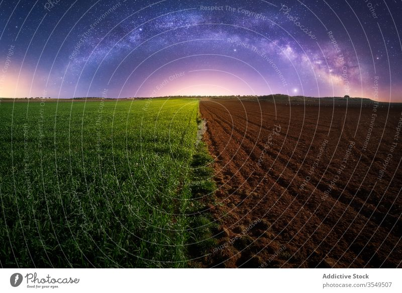 Agricultural green and plowed field agriculture half night milky way plant soil twilight landscape rural countryside galaxy starry farm magnificent farmland