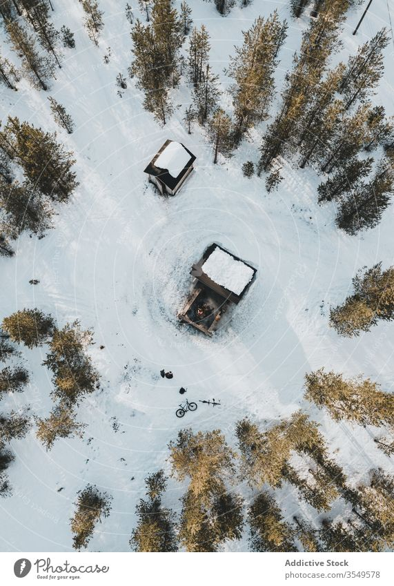 Small houses in winter forest lumberjack aerial snow countryside landscape nature cold finland tree pine rovaniemi travel tourism season rural white building