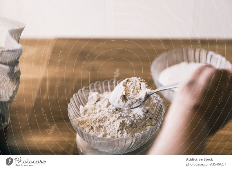 Housewife preparing ingredients for pastry bake scale weight homemade dough kitchen prepare cook housewife hand recipe food flour sugar bowl baker sweet dessert