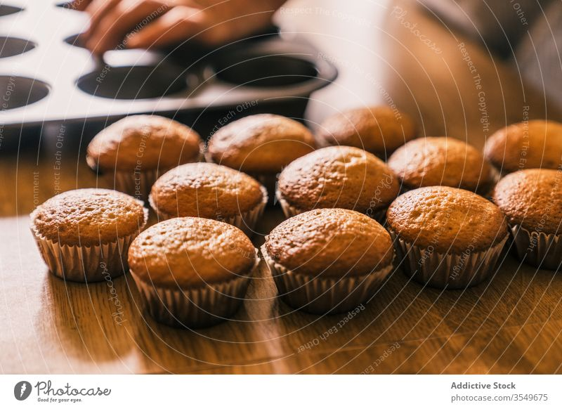 Ready to eat baked muffins delicious confectioner cook muffin case homemade kitchen tasty table dessert bakery product paper muffin liner wooden ready snack