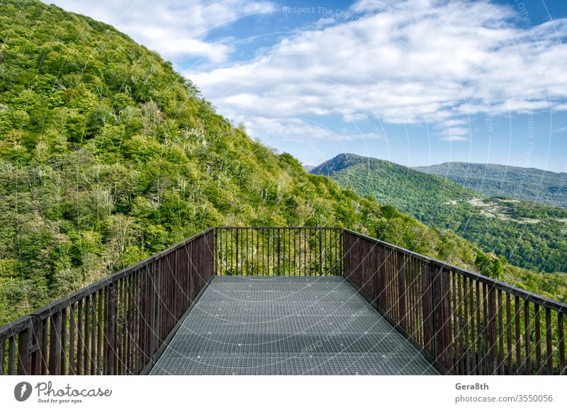 observation deck in canyon in Georgia Batumi Caucasus autumn blue branches bridge bright cliff climate clouds color construction day forest green hanging high