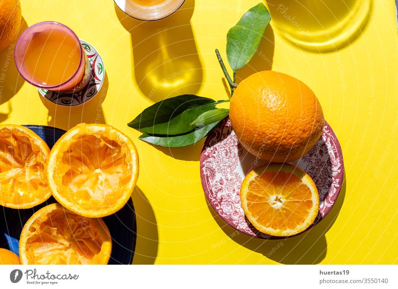orange juice from above on colored backgrounds. oranges fresh fruit healthy food citrus ripe drink natural slice sunligth juicy beverage glass summer table