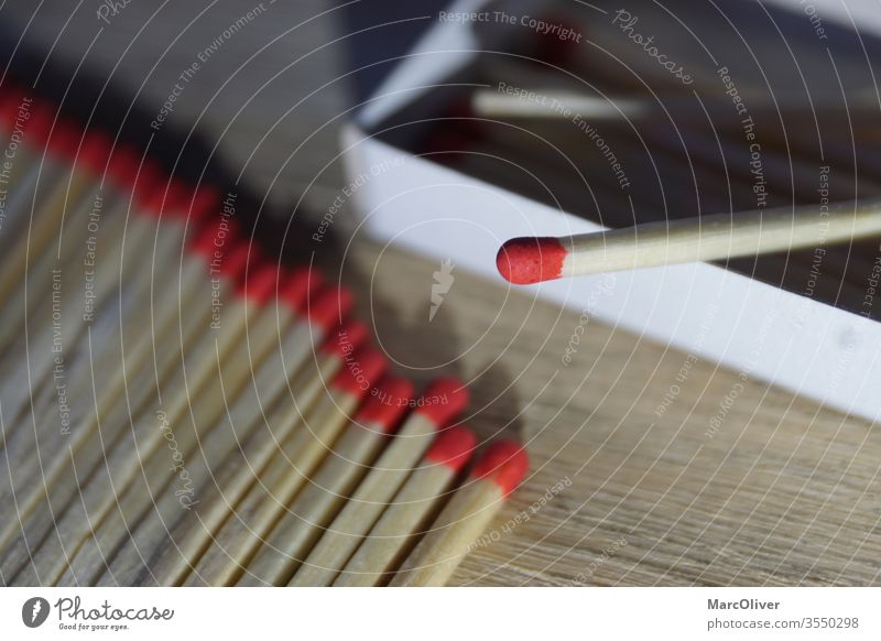 Red matches red matches Match Fire wood matchbox wooden Combustible peril Heat macro Ignite light firewood little sticks kindling Burn Close-up tongue-sticks