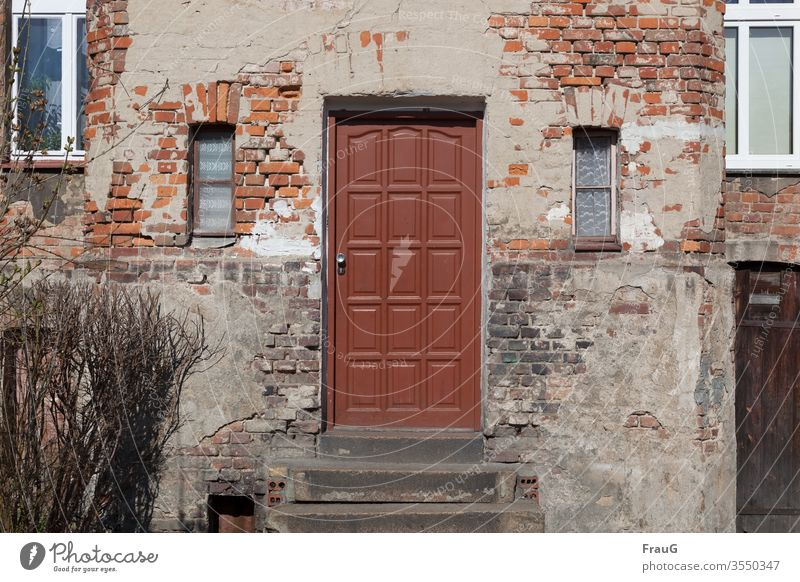 old | the house -the door is newer Facade House (Residential Structure) Brick facade bailer Old front door Ravages of time Window curtains stair treads dwell