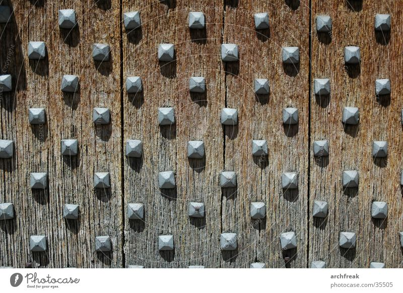 Medieval nubs of emotion... Church door Spain Catalonia Wood Iron Structures and shapes Oak tree Nail House of worship Medieval times Romanesque style Sun