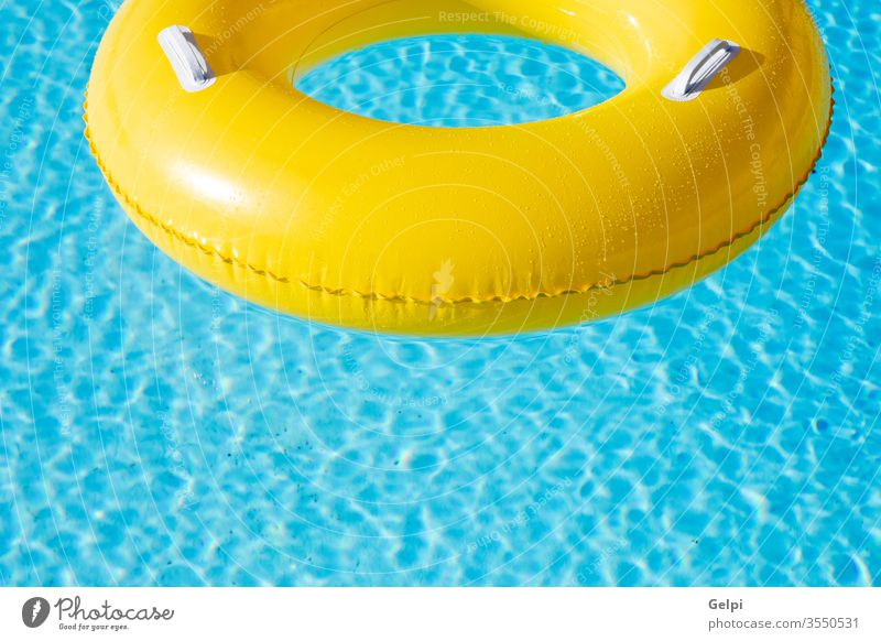 Yellow big float on pool resort blue water yellow nobody ring fun swim inflatable tropical travel summer hotel empty rubber wave space sun toy reflection