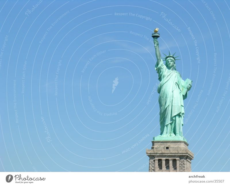 Statue of Liberty New York City Fairness Freedom Democratic Ellis Island USA Monumental Symbolism Isolated Image Copy Space left Blue sky Clear sky