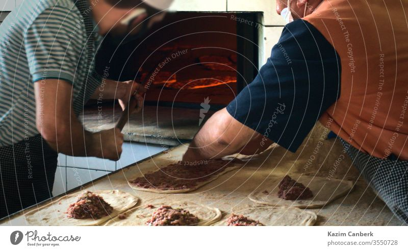 Two male bakers preparing and heating traditional turkish pita on Ramadan ramadan bakery cook food meal delicious tasty turkey muslim middle east cuisine fresh