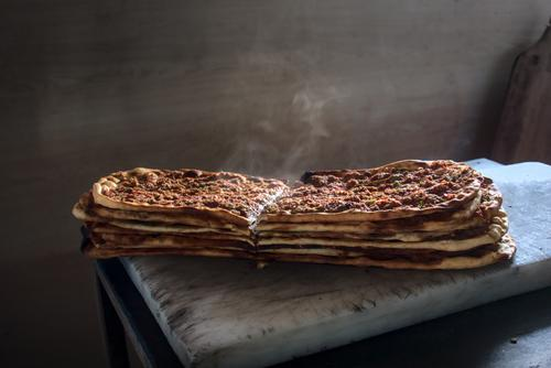 Delicious spicy and steamy stack of traditional Turkish pitas fresh out of oven ramadan baker bakery cook meat mince food meal delicious tasty turkey turkish