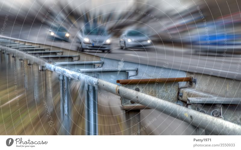 Guardrail at the motorway with cars in the background distorted by zoom effect Highway Crash barrier Zoom effect peril Street Transport Car Vacation & Travel