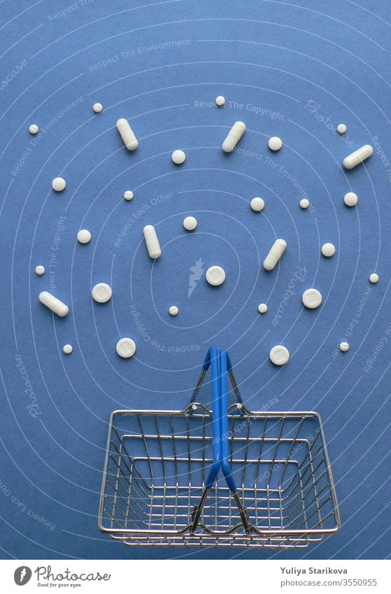 Shopping cart with medicine pills in pack on classic blue background with copy space. Treatment and of hope for recovery. Creative idea for drugstore, online pharmacy, health lifestyle and pharmaceutical company business concept.