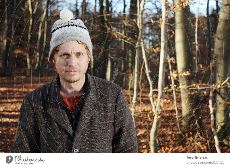 Man in the forest Masculine Adults 1 Human being 30 - 45 years Autumn Tree Forest Cap Blonde Funny Crazy Stupid Whimsical Coat Colour photo Exterior shot